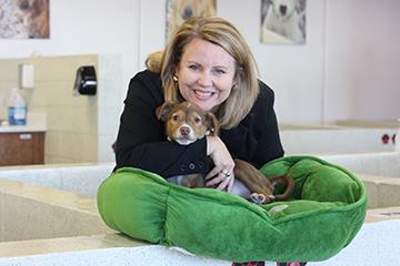 Dodie holding a puppy